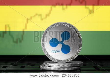 Ripple (xrp) Cryptocurrency; Physical Concept Ripple Coin On The Background Of The Flag Of Bolivia
