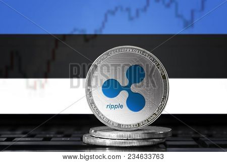 Ripple (xrp) Cryptocurrency; Physical Concept Ripple Coin On The Background Of The Flag Of Estonia