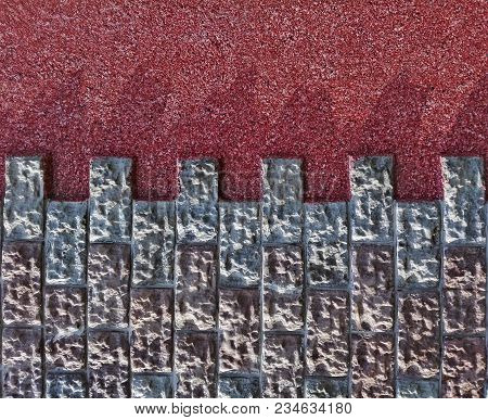 Decorative Stone Tile On Red Stucco Wall Frame Background Texture. Stucco Wall Natural Colorful Ston
