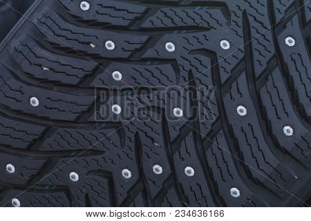 Close-up Of A Studded Tire Profile With Spikes For Winter Driving On Ice And Snow