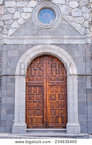 Carved Wooden Door With A Bull's-eye Of A Church Of San Pedro Apostol On The Island Of Tenerife In S