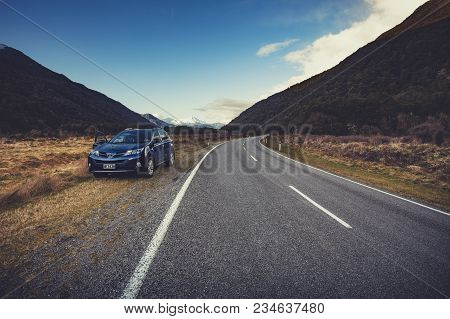 Appiring National Park Newzealand - Sep4,2015:suv Car Parking Beside Country Road In Traveling Route