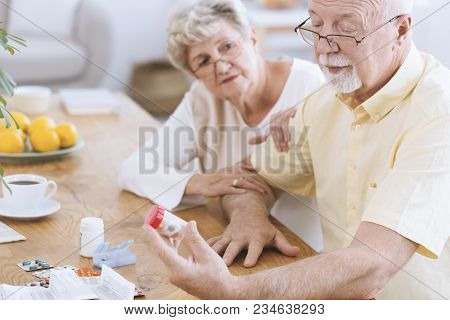 Old Couple Looking At Tablets