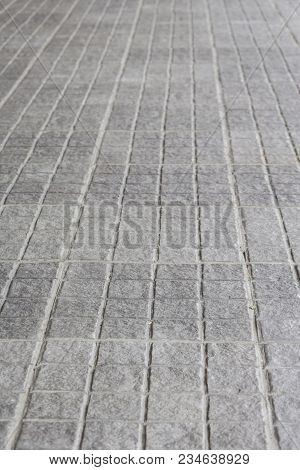 Background Of Perspective In Pattern Of Square Gray Pavement Street Floor, Shadow Depth Of Field.