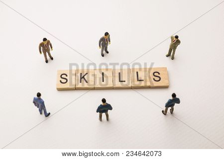 Miniature Figures Businessman : Meeting On Skills Word By Wooden Block Word On White Paper Backgroun