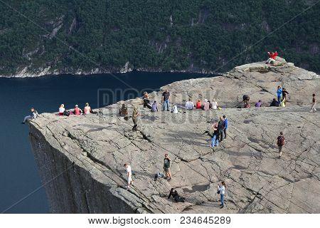 Preikestolen, Norway - August 11, 2010: Tourists Visit Famous Preikestolen Pulpit Rock In Norway. Ac