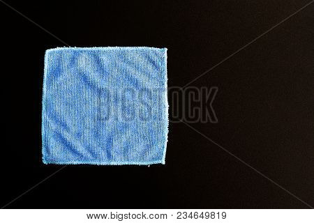 Blue Folded Microfiber Cloth On Black Table