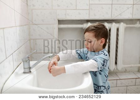 Kid Washes His Hands
