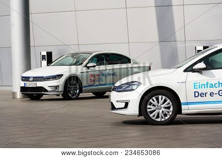 Dresden, Germany - April 2 2018: Plug-in Hybrid Electric Car Volkswagen Golf Gte Stands By Charging