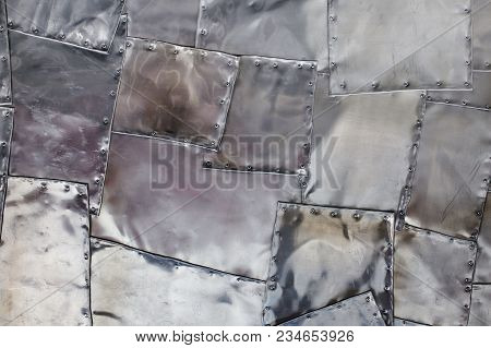 Silver Metallic Background. Metal Patches. Texture Of Old Metal With Rivets. Abstract Metallic Block