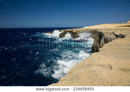 Wild Waves Of The Ocean Splash The Dry Shores Of Gozo, Malta