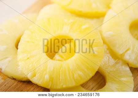 Pieces Of Pineapple. Pineapple Cut Into Pieces On A Wooden Cutting Board.
