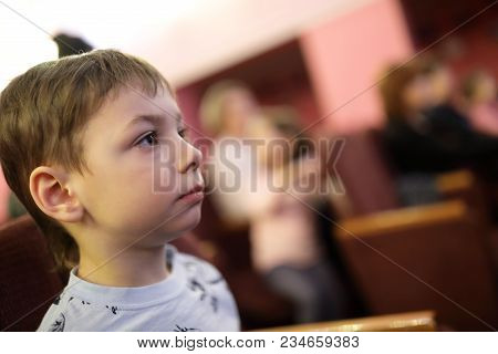 Child Watching Theatrical Performance