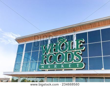 Irving, Tx, Us-apr 3, 2018:close-up Exterior Facade Logo Of Whole Foods Market Store. An Eco-minded