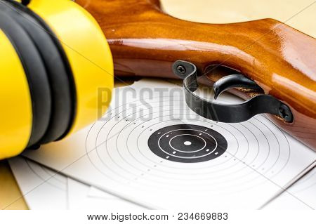 Pneumatic Weapons On The Shooting Range. Shooting Accessories On A Wooden Table.