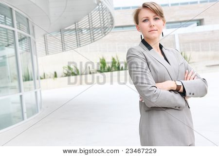 A pretty business woman outside office building