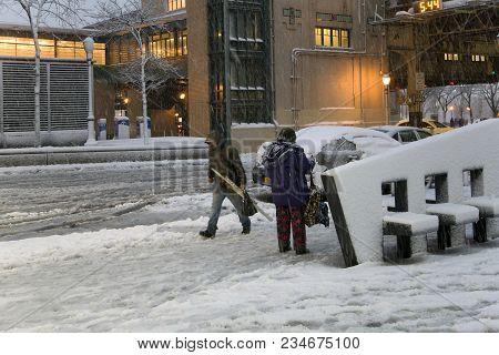 Bronx, New York - March 7: People In Snow Storm Near Yankee Stadium.  Taken March 7, 2018 In New Yor