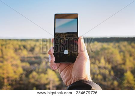 Close Up Of Male Hand Holding Smart Phone And Taking Photo Of Landscape Touchscreen Display Capture
