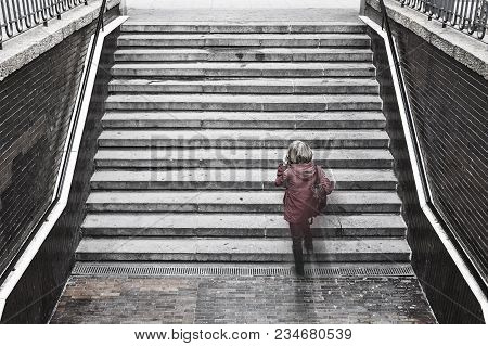 Woman Talking With Cellular Phone. Urban Life. Loneliness. Horizontal