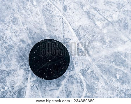 Hockey Puck On The Ice And Snow Texture, Copyspace And Text