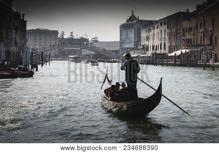 Venice, Italy - March 28, 2018: Gondolas Sail Along The Canal Grande. Gondola Is The Most Attractive