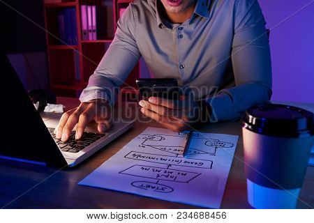 Unrecognizable White Collar Worker Sitting At Desk Of Dim Office And Dialing Number Of Client While