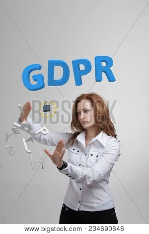 GDPR, concept image. General Data Protection Regulation, the protection of personal data. Young woman working with information.