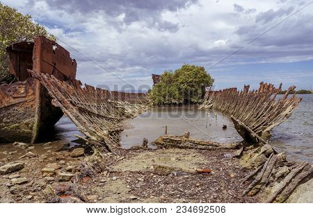 The Corroding Shell Of A Steel Hulled Ship Wreck Partially Submerged At Garden Island, Port Adelaide