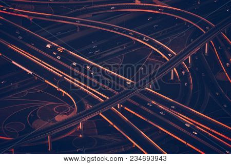 Dubai aerial view, road junction at night time, beautiful engineering miracle, transport on the highway, modern construction, abstract background