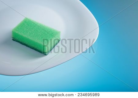 White Dish And Sponge For Dishes . Hygiene. Wash The Dishes . Copy Space.