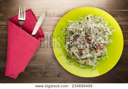 Salad Daikon, Onions And Dill On A Wooden Background. Salad On A Plate