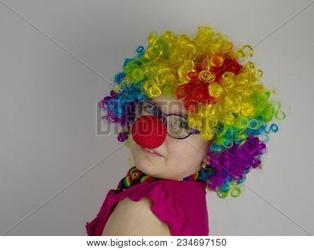 Little Girl In Clown Costume .little Girl With Glasses In Colorful Clown Costume.