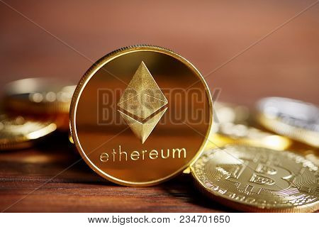 Ethereum On The Pile Of Cryptocurrency Over Wooden Table As Most Important Cryptocurrency Concept, C