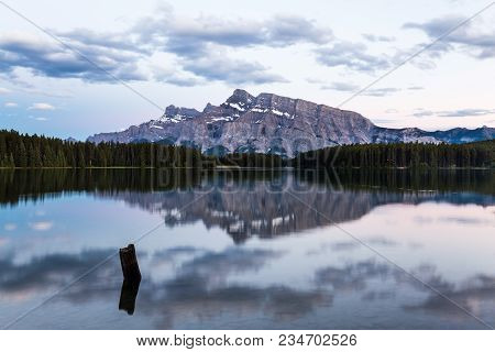Mountains And Surrounding Coniferous Forests Reflected In The Tranquil Water Of Two Jack Lake, Banff