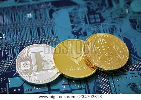 Digital Cryptocurrencys Bitcoin, Ethereum And Litecoin On The Motherboard. Cryptocurrency Concept, C