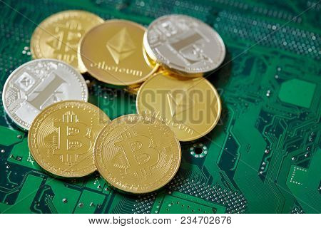 Stack Of Cryptocurrencies In A Circle On The Motherboard. Cryptocurrency Concept, Close-up, Selectiv