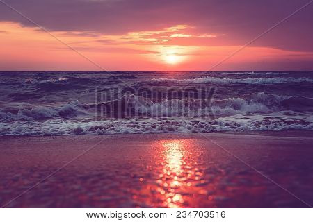 A Beautiful Sunrise On Sanibel Island Florida. Bright Intense Pink Purple Orange Sunrise At The Sea.
