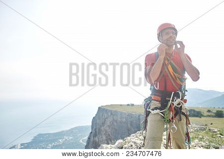 Man Rock Climber Climbed On The Cliff. Happy Climber On The Top Of The Mountain.