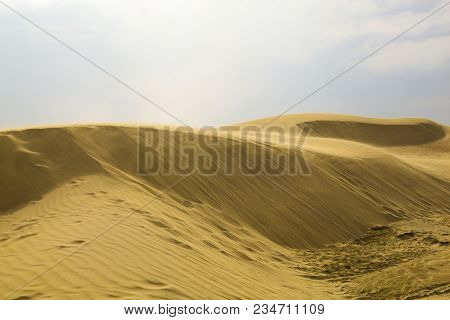 Desert Dune. Sand And Wind In Hot, Windy Weather. The Ridge. Hills And Dunes, In Summer In The Heat
