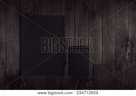Blank Black Letterhead, Notepad, Business Card On Dark Wood Board. Mock Up For Branding, Business Pr