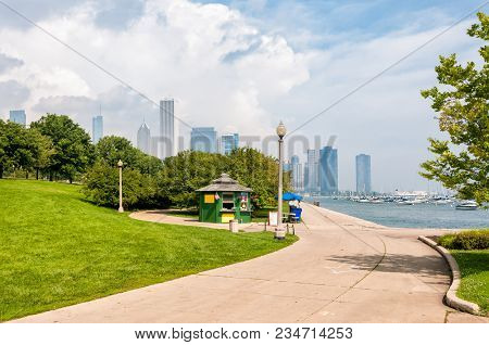 Park Walkway Of Lake Michigan With Chicago Skyline In The Background, Usa