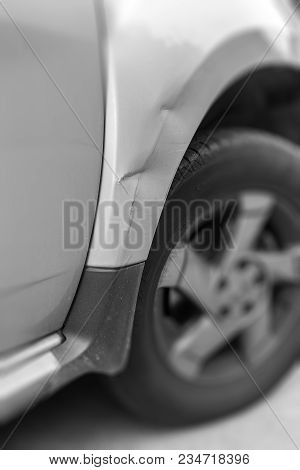 Dents On The Car Caused By The Accident. Shallow Depth Of Field.