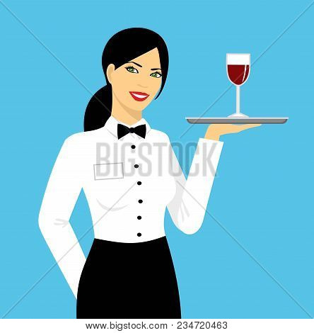 Young, Beautiful, Smiling Girl Is A Waitress In Uniform. Waitress With A Glass Of Wine On A Tray