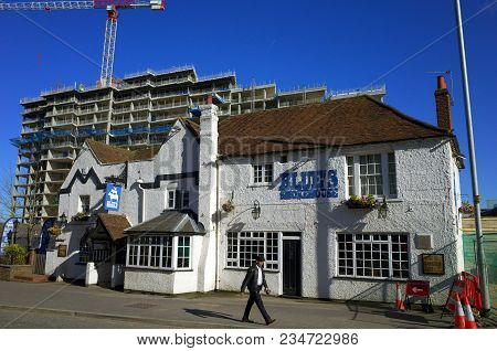Bracknell, England - April 05, 2018: A Pedestrian Passes By The Blues Smokehouse, Formerly A Pub And