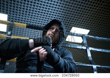 The Portrait Of Mma Fighter Wrapping Up Before The Fight.mma Fighter Preparation
