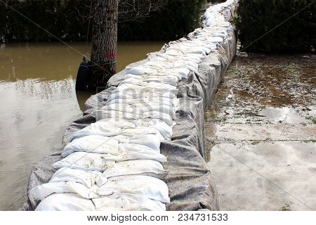 Sandbox Barriers Flood Protection Completely Covered With Geotextile Fabric And Sandbox Flood Protec