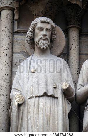 PARIS, FRANCE - JANUARY 04: Saint Bartholomew, Portal of the Last Judgment, Notre Dame Cathedral, Paris, UNESCO World Heritage Site in Paris, France on January 04, 2018.
