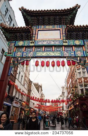 London, United Kingdom - March 6 2018: People Walking In The Streets Of The Famous China Town Dresse