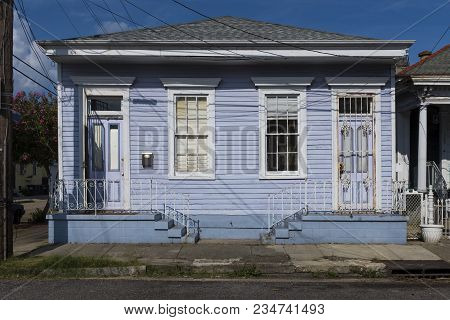 The Facade Of A Traditional Colorful House In The Marigny Neighborhood In The City Of New Orleans, L
