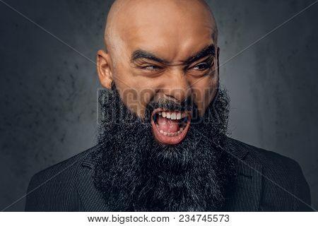 Portrait Of Screeching Bearded Shaved Head Islamic Male.